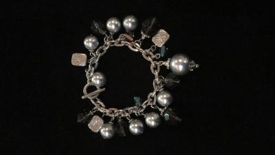 Charming Silver Tone Bracelet
